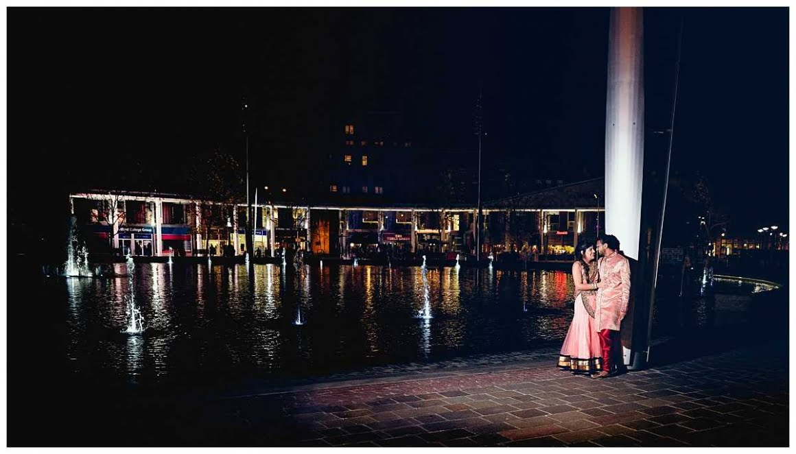 wide shot of bride and groom with bradford city in the background