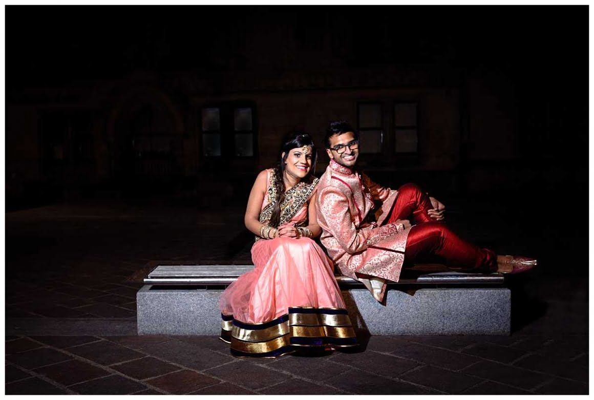 Bride and groom sit on a bench posed - lit using fash and magmod sphere