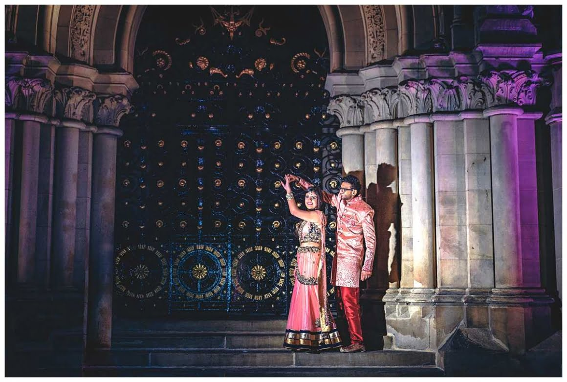 bride and groom dancing on bradford town hall steps, using magmod lighting again