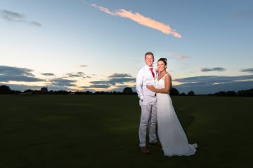 Bride and Groom pose at Sunset at waterton hall golf course wakefield
