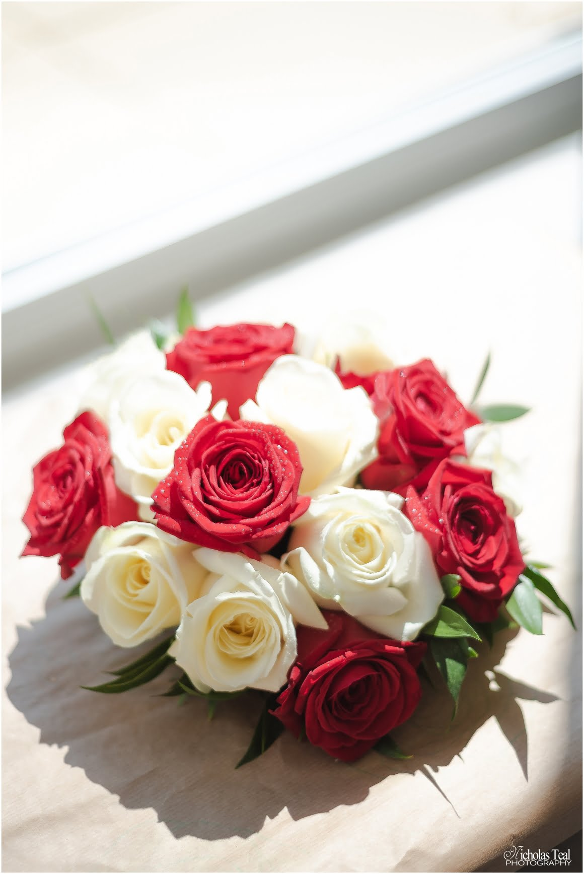 the brides flowers, red roses and white roses