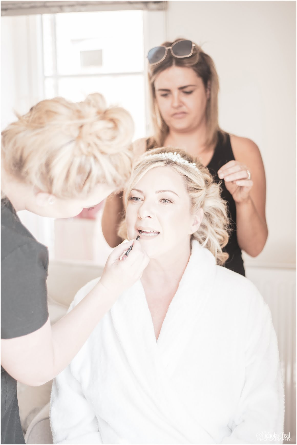 Close up of bride getting makeup done and hair