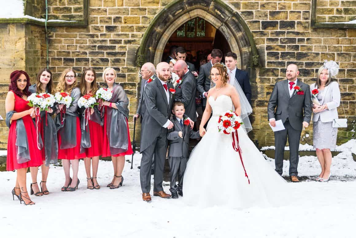 In this images the bride and groom and brides maids can be seen coming out of the church on a snowy day, snow is on the floor