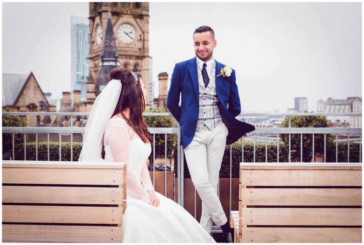 Picture of bride and Groom looking at each other on the rooftop at King Street Townhouse Manchester