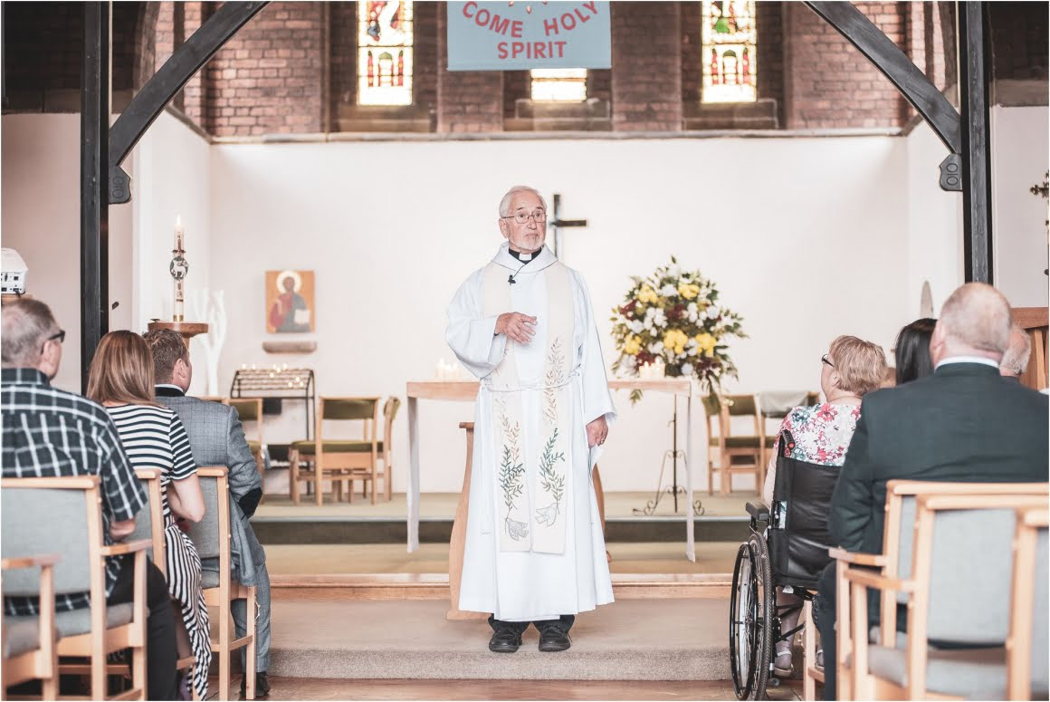 Harry's Christening at St Anne Wrenthorpe - picture of the vicar