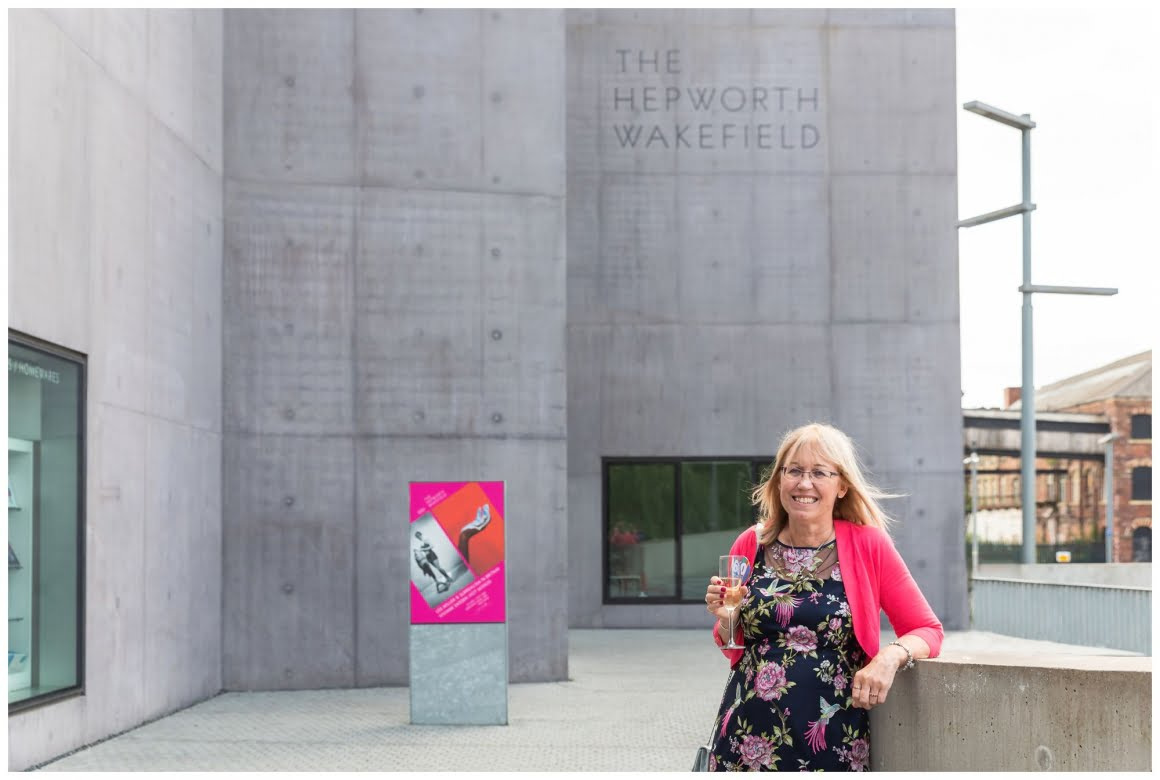 rosemary outside the hepworth wakefield with the sign in the back ground