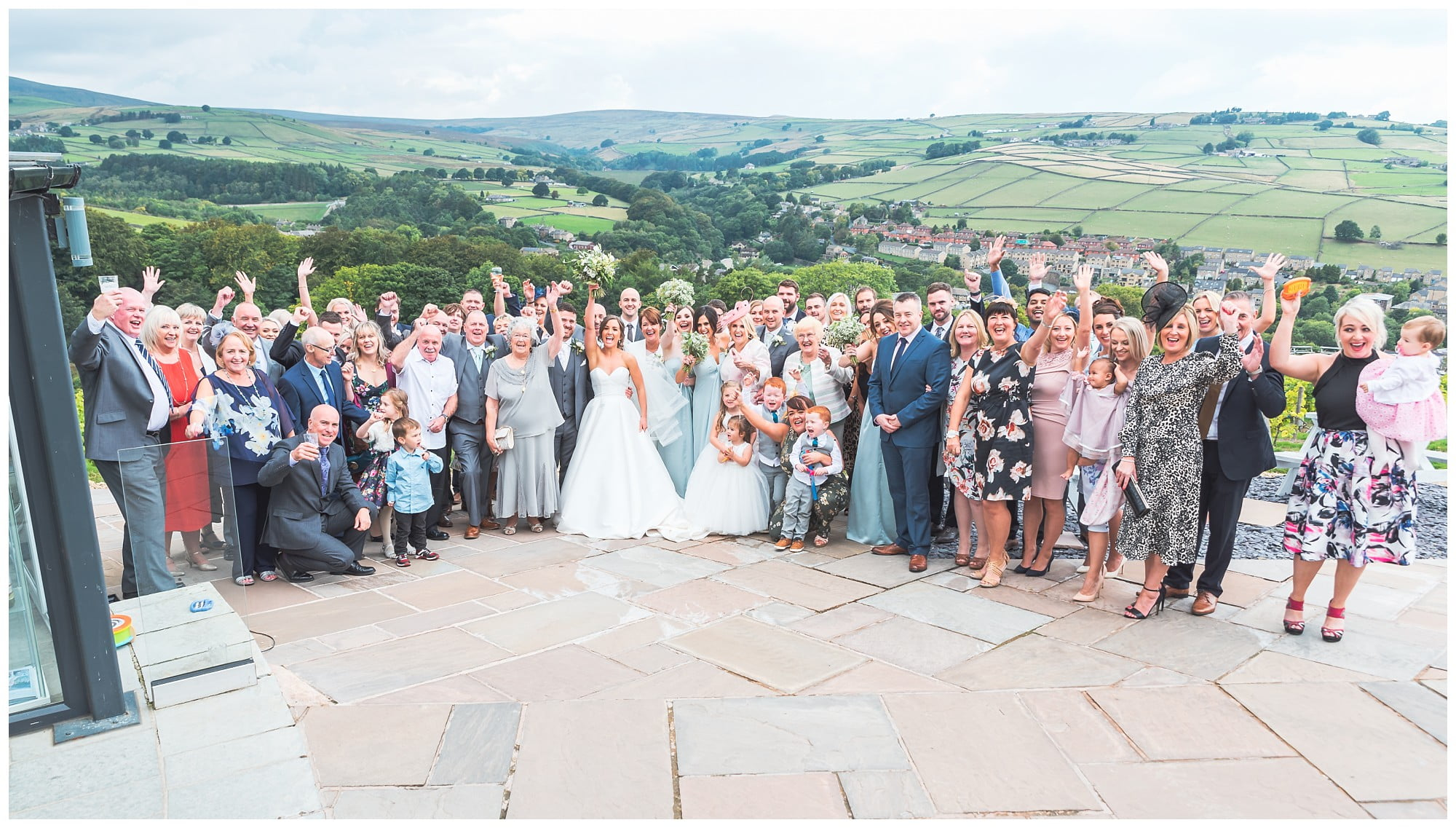Wedding guest Group shot from the top of the vineyard looking out to the hills - Holmfirth vineyard