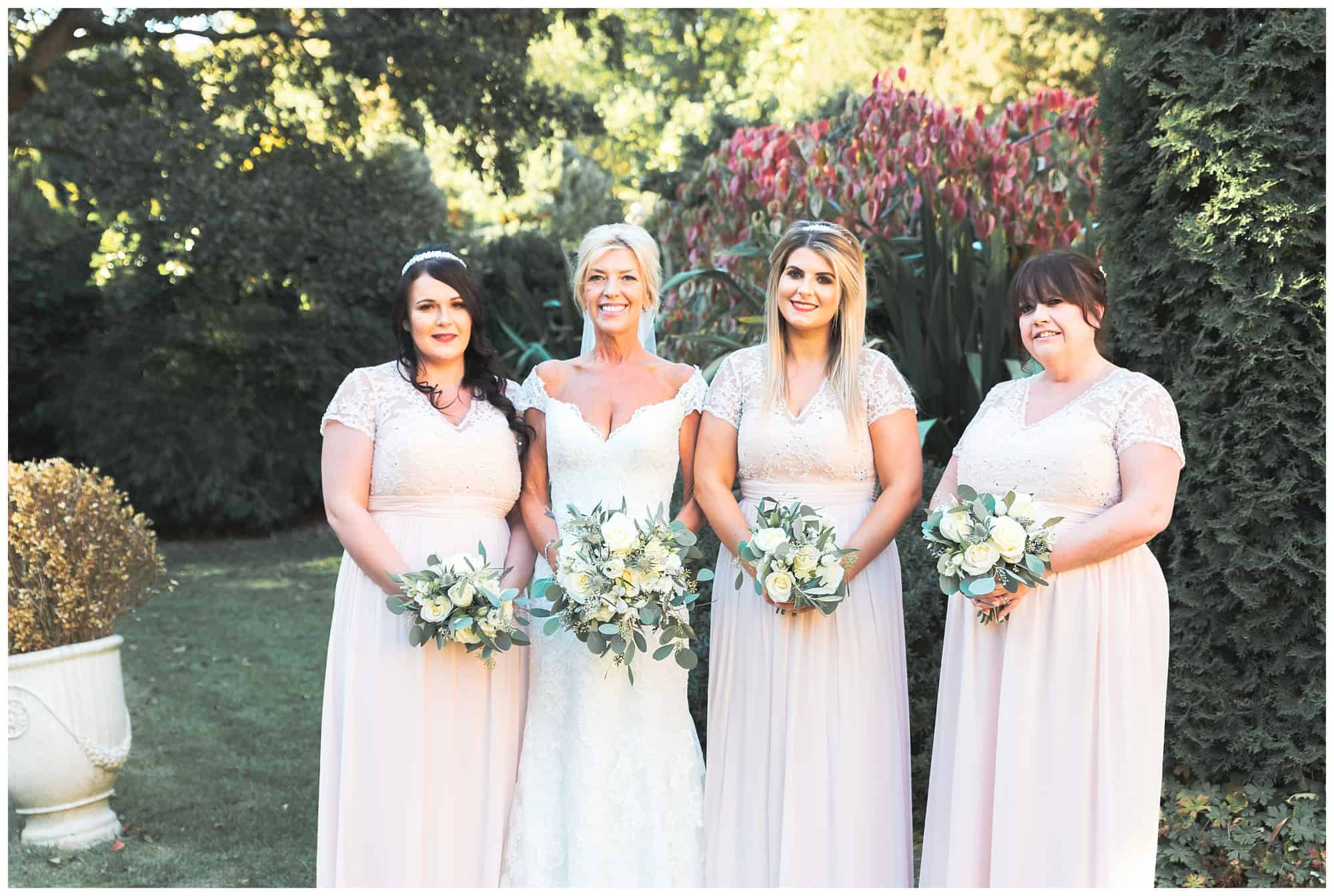 Whitley Hall Hotel Wedding - outside bride with her brides maids