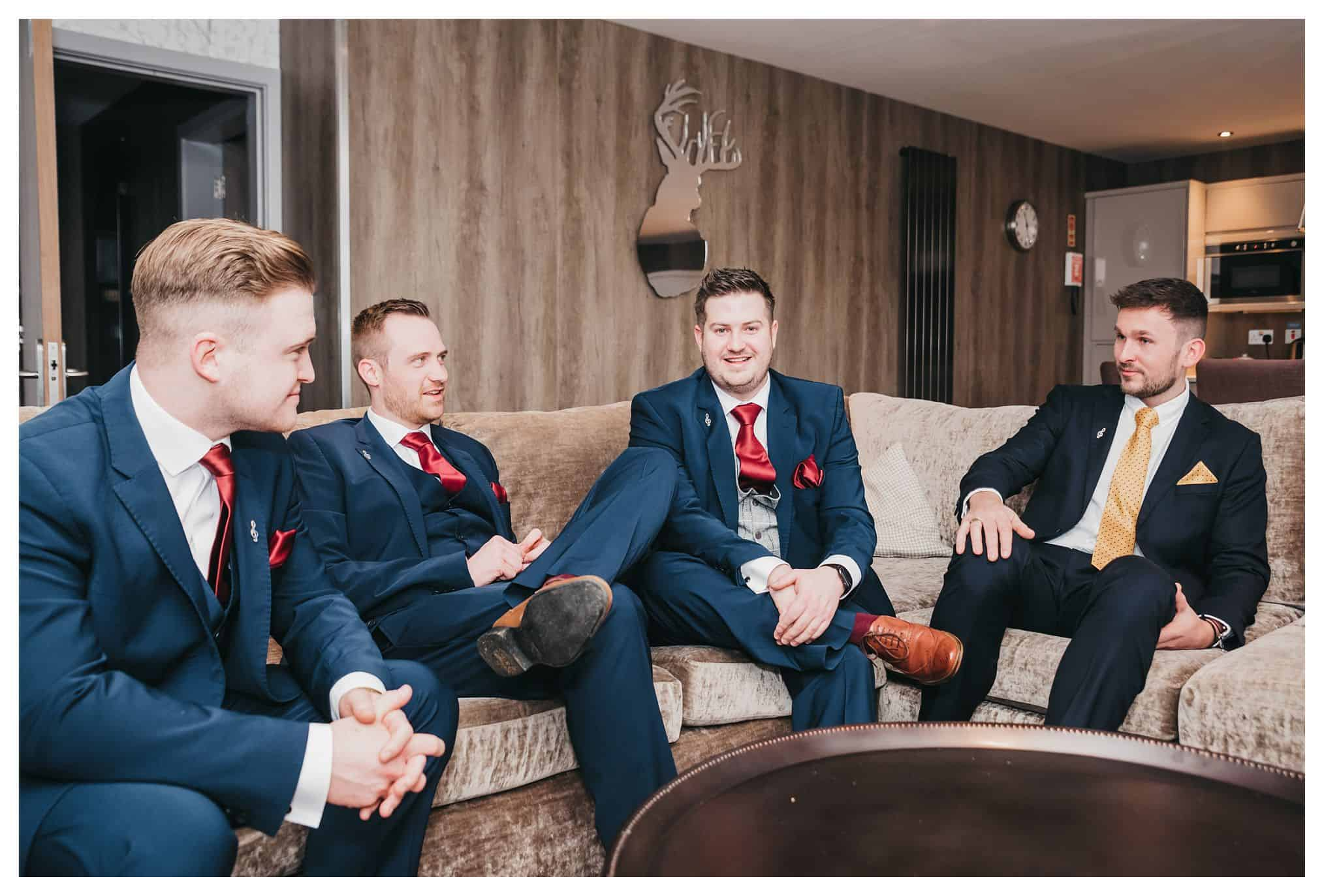 picture of groomsmen sitting down