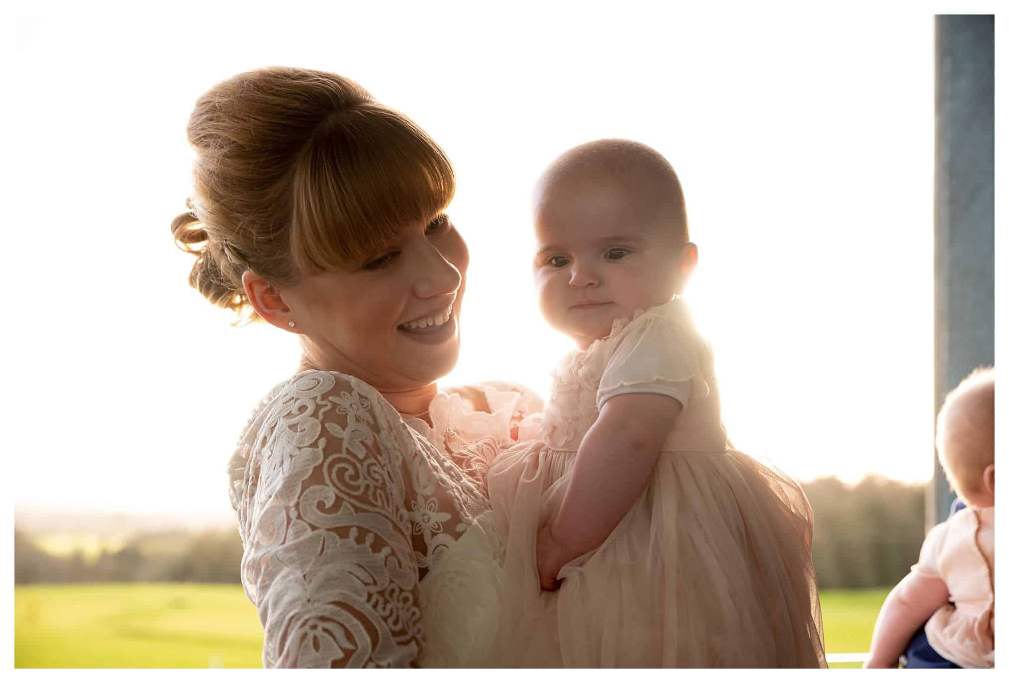 bride holding cute baby