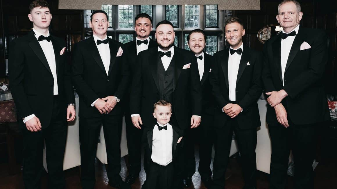 group shot of groomsmen wearing black tux