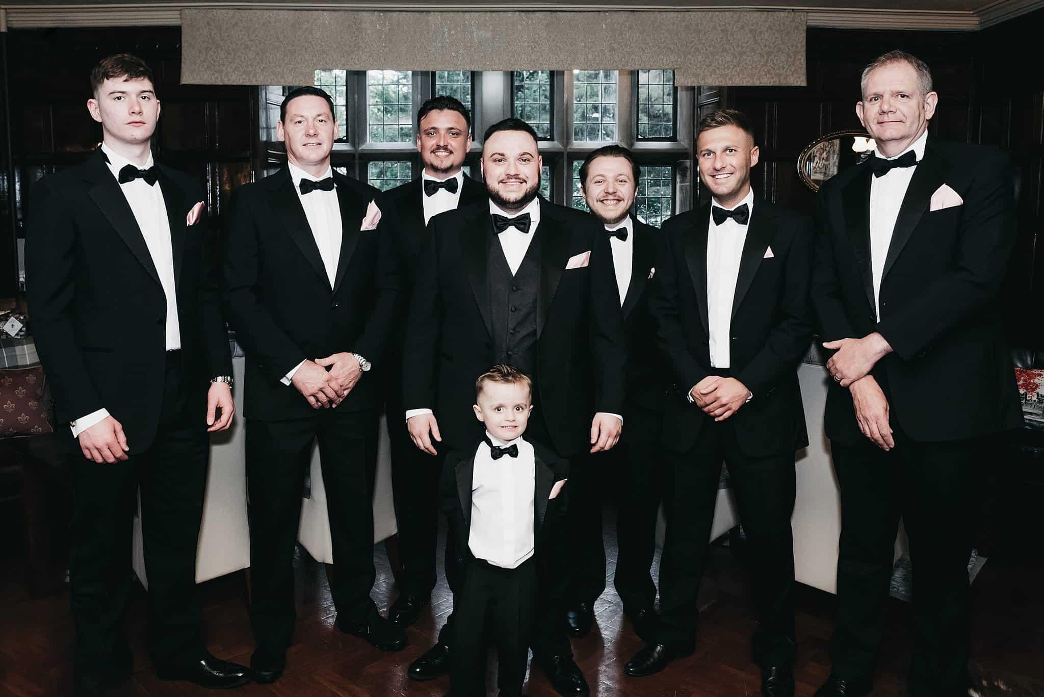 group shot of groomsmen wearing black tux