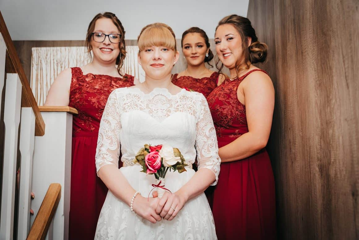 Picture of the bride with her friends on steps