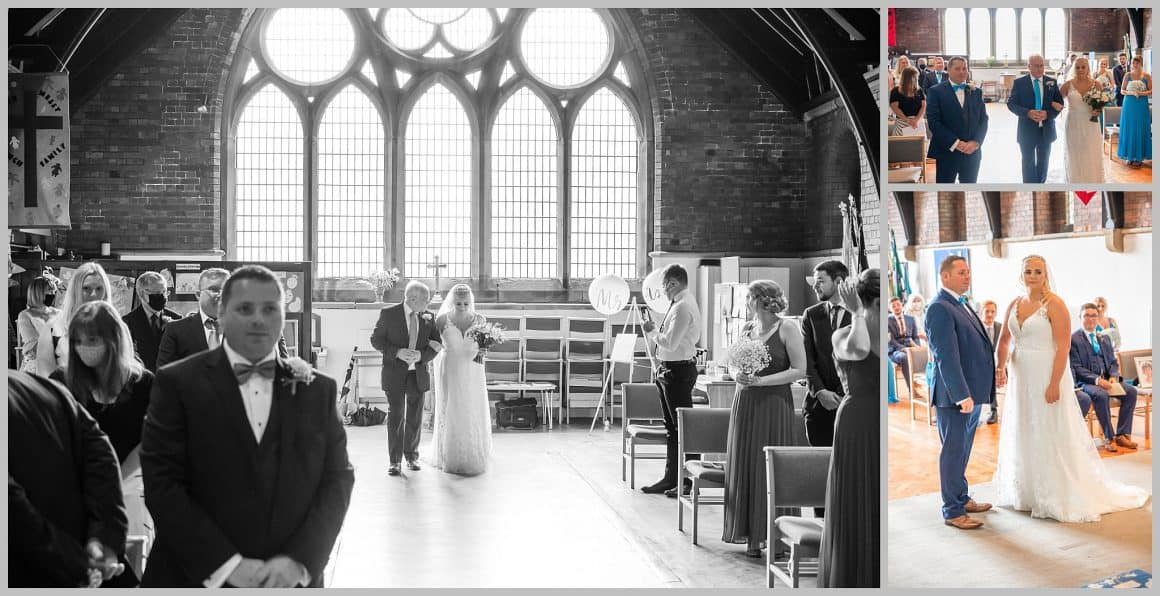 Inside the church picture of bride walking down the isle at  ST. ANNE'S CHURCH WRENPHOPRE , Wakefield