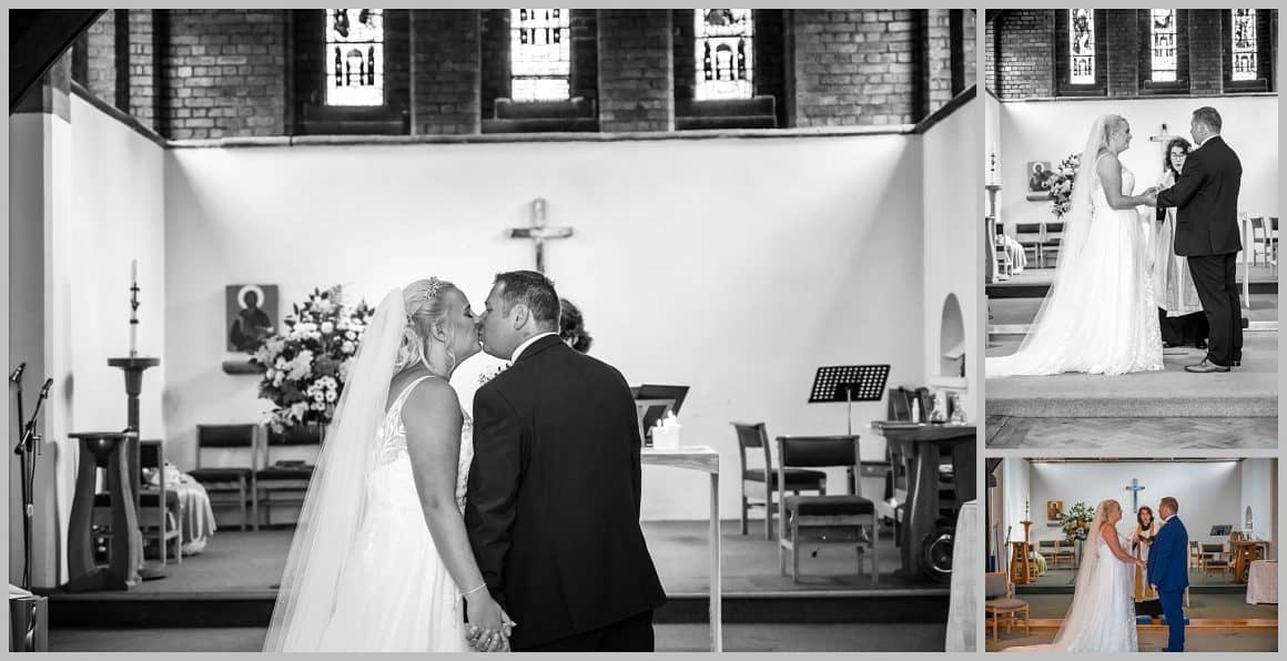 Bride and groom kissing at  ST. ANNE'S CHURCH WRENPHOPRE , Wakefield