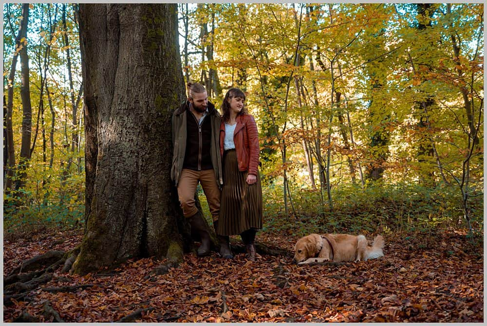 this images shows my couple stood next to a oak tree they are playing with there dog at  Rivelin Valley sheffield