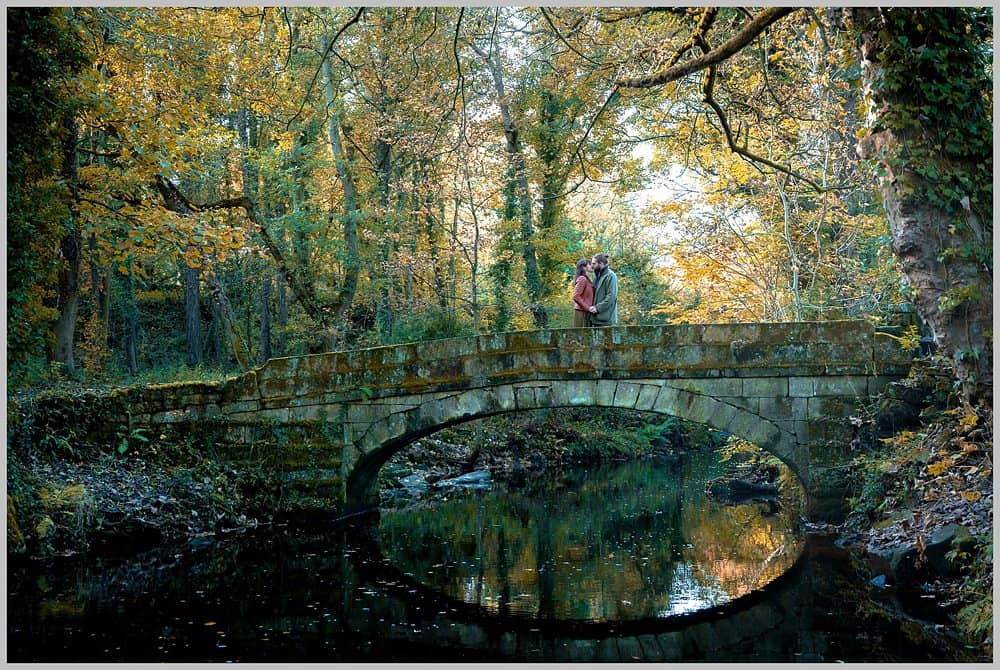 this image shows my couple posing on the stone bridge at  Rivelin Valley sheffield