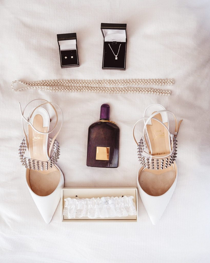 This is lay flat image of the brides shoes perfume neckless rings