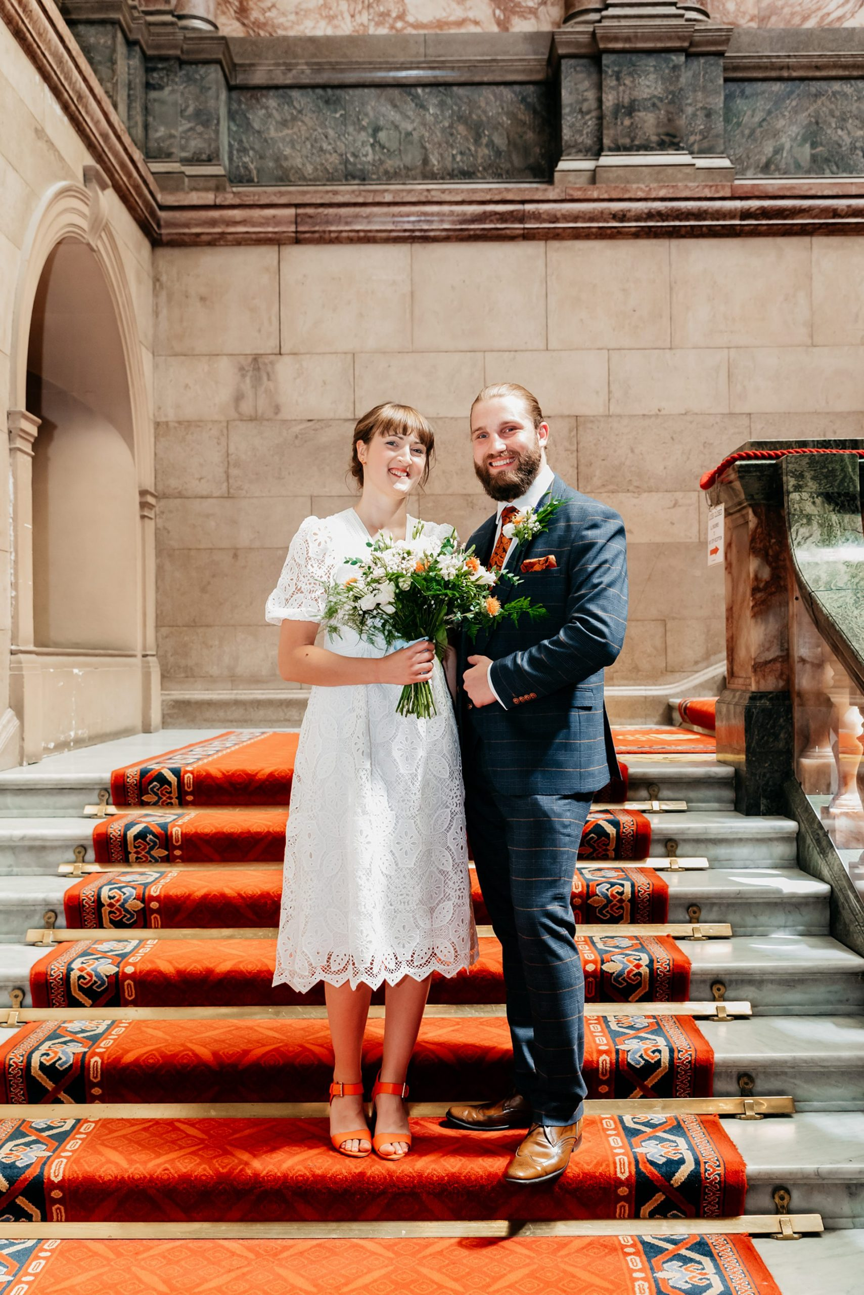 Grand staircase image at Sheffield Town Hall, Bride and Groom pose on steps