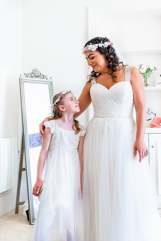 Bride poses with young bridesmaid Bridal Preparations White Hart Hotel, harrogate, White Hart Hotel wedding photos, White Hart Hotel wedding photographer