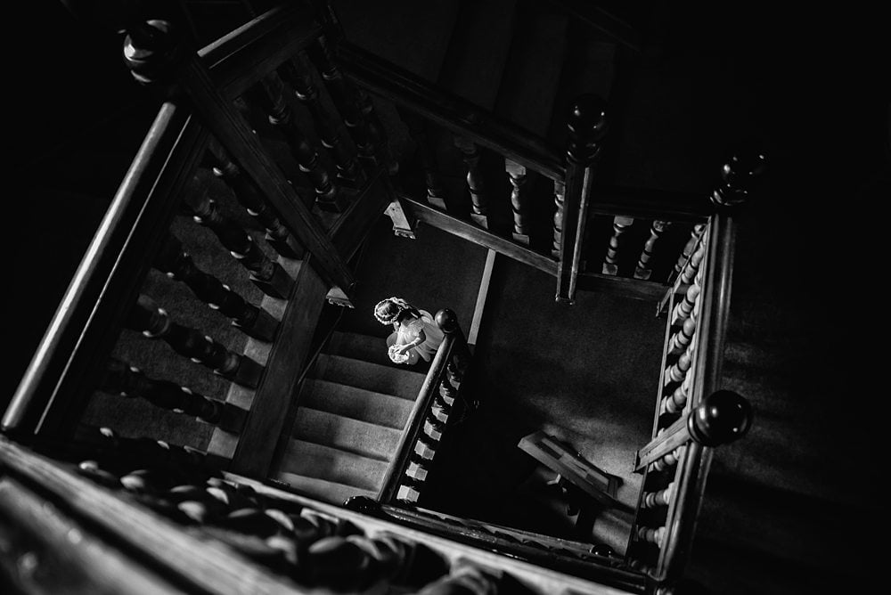 Bride walking up a Historic staircase photograph Fountains Hall Rippon, Fountains Hall Rippon Photos, Fountains Hall Wedding photographer
