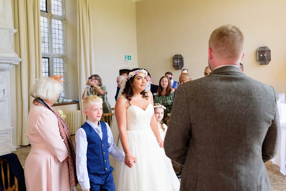 Bride arriving at service photograph Fountains Hall Rippon, Fountains Hall Rippon Photos, Fountains Hall Wedding photographer