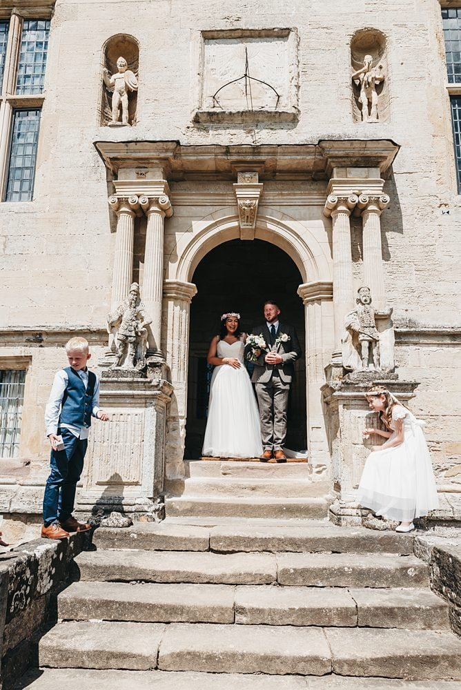 Bride and Grooms Kids Wait to throw confetti photograph Fountains Hall Rippon, Fountains Hall Rippon Photos, Fountains Hall Wedding photographer