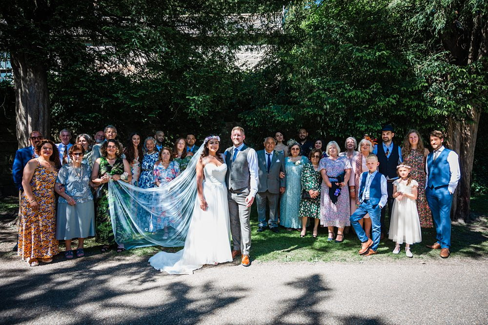 group shot of wedding party at Fountains Abbey, Rippon