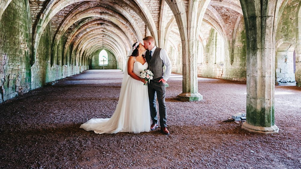 Bride and Groom pose inside Fountains Abbey Rippon, Fountains Abbey Rippon Photos, Fountains Abbey Wedding photographer