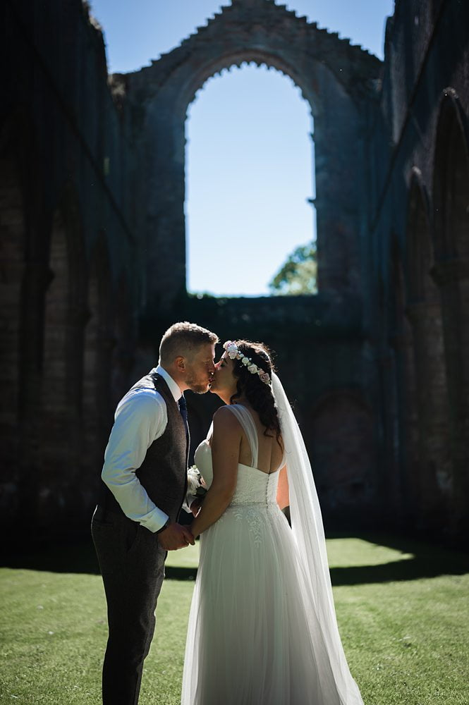 Bride and Groom Kissing photograph Fountains Abbey Rippon, Fountains Abbey Rippon Photos, Fountains Abbey Wedding photographer
