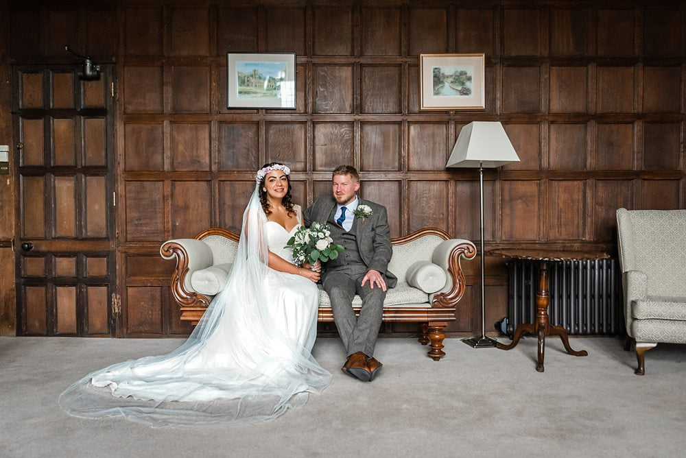 Bride and Groom sit-down Fountains Hall Rippon, Fountains Hall Rippon Photos, Fountains Hall Wedding photographer photograph