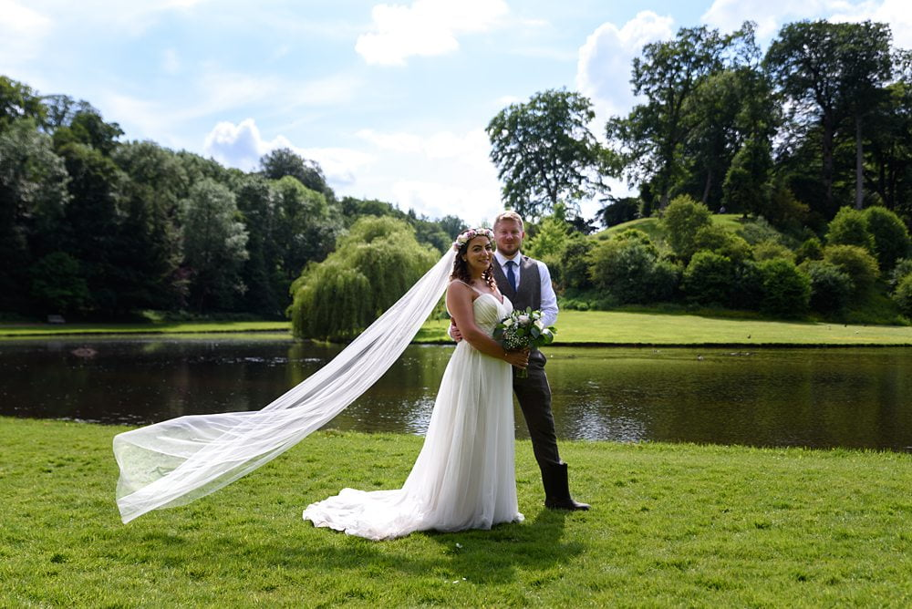 Bride and Groom pose next to river Fountains Abbey Rippon, Fountains Abbey Rippon Photos, Fountains Abbey Wedding photographer