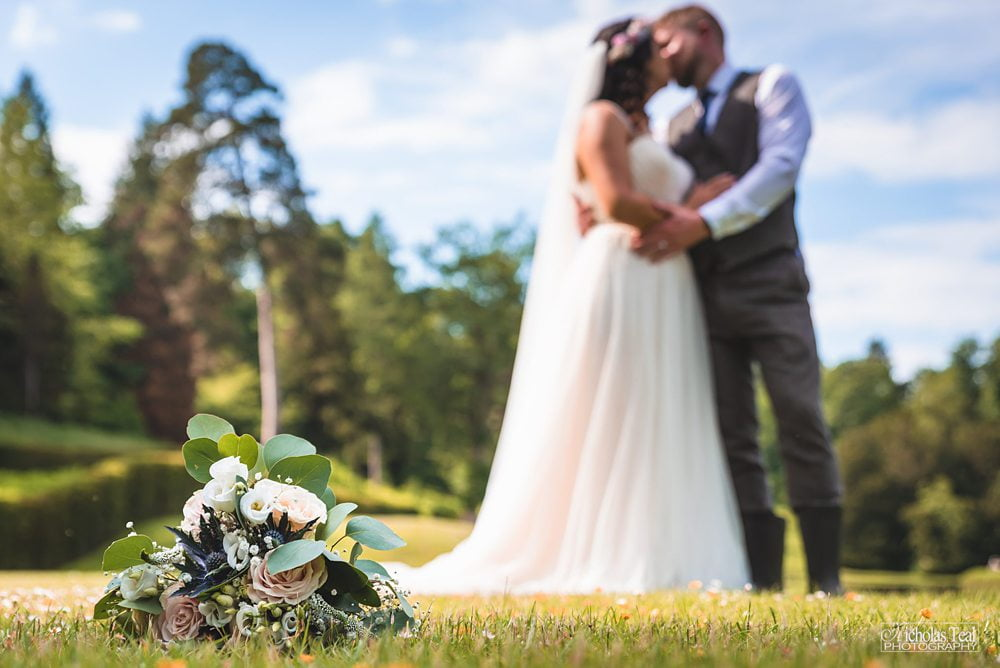 bride and groom in the gardens at Fountains Abbey