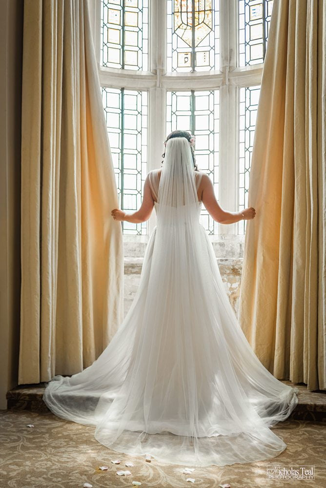 Bride Opening curtains photograph Fountains Hall Rippon, Fountains Hall Rippon Photos, Fountains Hall Wedding photographer