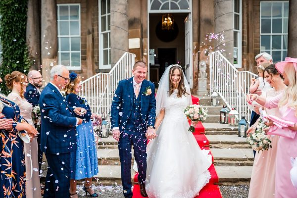 Bride and Groom confetti shot outside on red carpet Wood Hall Hotel, Wetherby, wood hall Wetherby wedding photography